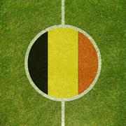 Football field center closeup with Belgian flag in circle - stock illustration