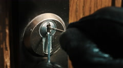 Burglar pick lock frontdoor extreme close-up 4/4 Stock Footage