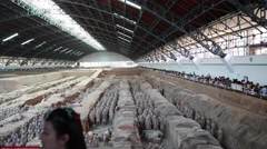 Crowds of tourists viewing the Terracotta Warriors Stock Footage