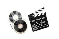 Vintage 8mm movie reels and clapper board white background Stock Photos