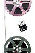 Vintage 8mm purple and grey movie reels and little clapper board - stock photo