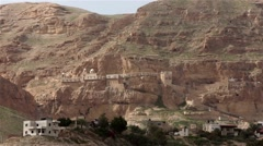 Monastery of the Temptation located in rocks of mountains - Orthodox Christian Stock Footage