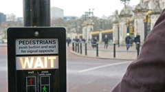A pedestrian pushing the button on the signage Stock Footage