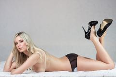 attractive lying naked blond girl - stock photo