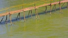 Bamboo Bridge over River near Luang Prabang, Laos Stock Footage