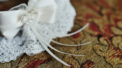 The garter of the bride laying on a pillow and prepared for wedd Stock Footage