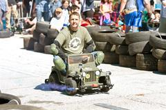 Man Races Miniature Army Jeep At Fair Stock Photos