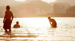 Friends play in the water in Rio de Janeiro. Stock Footage