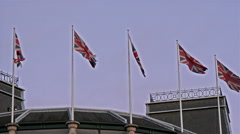 Five England flags waving on the flag poles Stock Footage