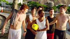 Friends walking down the street in Brazil with a soccer ball. Stock Footage