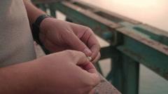 FISHERMAN PREPARING FISH HOOK Stock Footage