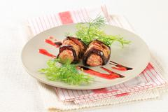 Appetizer - Meatballs wrapped in slices of eggplant Stock Photos