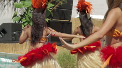 Polynesian dance troupe performing traditional hula dance Stock Footage
