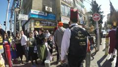 People walk in the main street during Purim Stock Footage