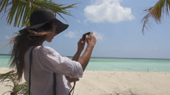 Young Woman Photographer Discovers Pristine Tropical Beach - stock footage