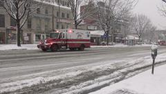Ambulance arrives in snow, see fire trucks Stock Footage