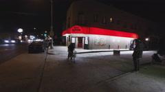 Man Exits Bar Tavern Saloon Low Angle Night Stock Footage