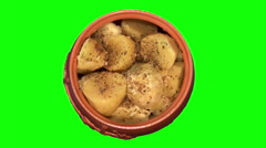 Potatoes with spicery in pot, top shot Stock Footage