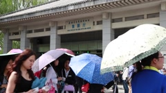 Tourists in front of the ticket office at Terra Cotta warriors Stock Footage