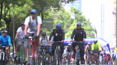 BPMX55-Mexico, 2 policemen on bikes & hundreds riders on street. Low angle, wide Stock Footage