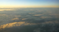 Aerial shot of clouds from airplane beautiful clouds during sunrise 4k UHD - stock footage