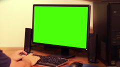 Working on a computer with key green screen Stock Footage