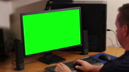 Stock Video Footage of Man working on a computer with a key green screen