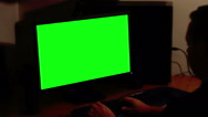 Stock Video Footage of Creepy man working on a computer with a key green screen
