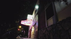 Man Walks From Neighborhood Tavern Pub Bar- Night Stock Footage