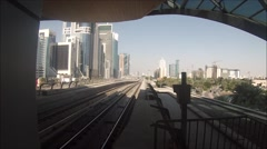 Unmanned metro train departs from a station in Dubai UAE Stock Footage
