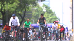 BPMX52-Mexico, hundreds of bikes on street. Low angle, wide, focus on FG Stock Footage