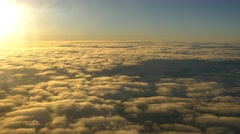 Aerial shot of clouds from airplane beautiful clouds during sunrise 4k UHD Stock Footage