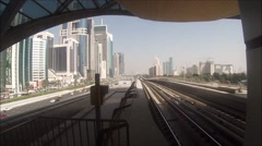 Unmanned metro train arrives at a station in Dubai UAE Stock Footage