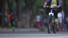 BPMX63x-Mexico, biker & skater, more bikes on BG. Low angle, no faces, mid shot. Stock Footage