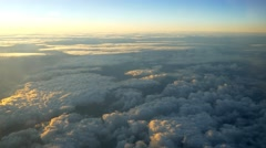 Aerial Shot Clouds Airplane golden clouds sunrise 4k UHD fly through landscape Stock Footage