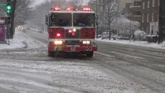 Fire Engine arrives & passes in Snow, siren, DC Stock Footage
