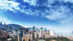 Couseway Bay, Hong Kong, China - panoramic timelapse of white clouds over city Stock Footage