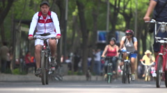 BPMX60-Mexico, dozens of bike riders on street. Low angle, wide, selective focus - stock footage