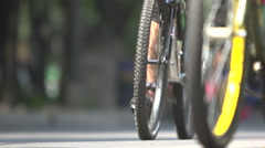 BPMX68x-Mexico, bike tires in focus, soft BG w/ more bikes. Low angle, no faces, Stock Footage