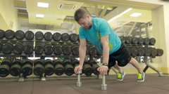 Training with dumbbells in the gym Stock Footage
