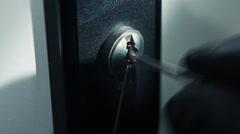 Burglar pick lock office door close-up 3/6 Stock Footage