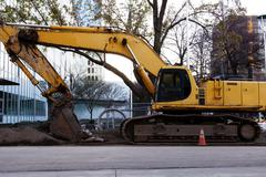 Large Heavy Construction Equipment Idle Downtown Site Stock Photos