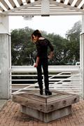 Skinny Asian American Woman Standing Black Pants - stock photo