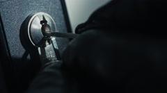 Burglar pick lock office door close-up 4/6 Stock Footage