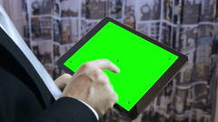 Young businessman using a tablet computer: alpha channel, green screen Stock Footage
