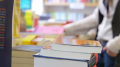 Searching for a book in the bookshop Stock Footage