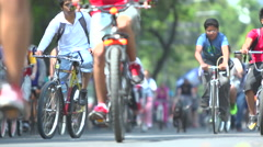 BPMX83-Mexico, hundreds of bikes, child, dog. Low angle, wide, selective focus. - stock footage