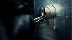 Burglar pick lock office door close-up 6/6 Stock Footage