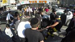 Drunk reveler celebrate Purim, Haredi talks on mobile phone Stock Footage
