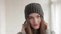 Young beautiful fashionable woman in big dj headphones Stock Footage